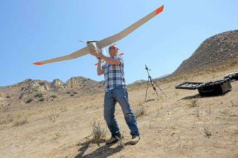AeroVironment's Kris Waters prepares to launch an unmanned aircraft during a morning of testing in Simi Valley, CA. (Andy Holzman/Staff Photographer)