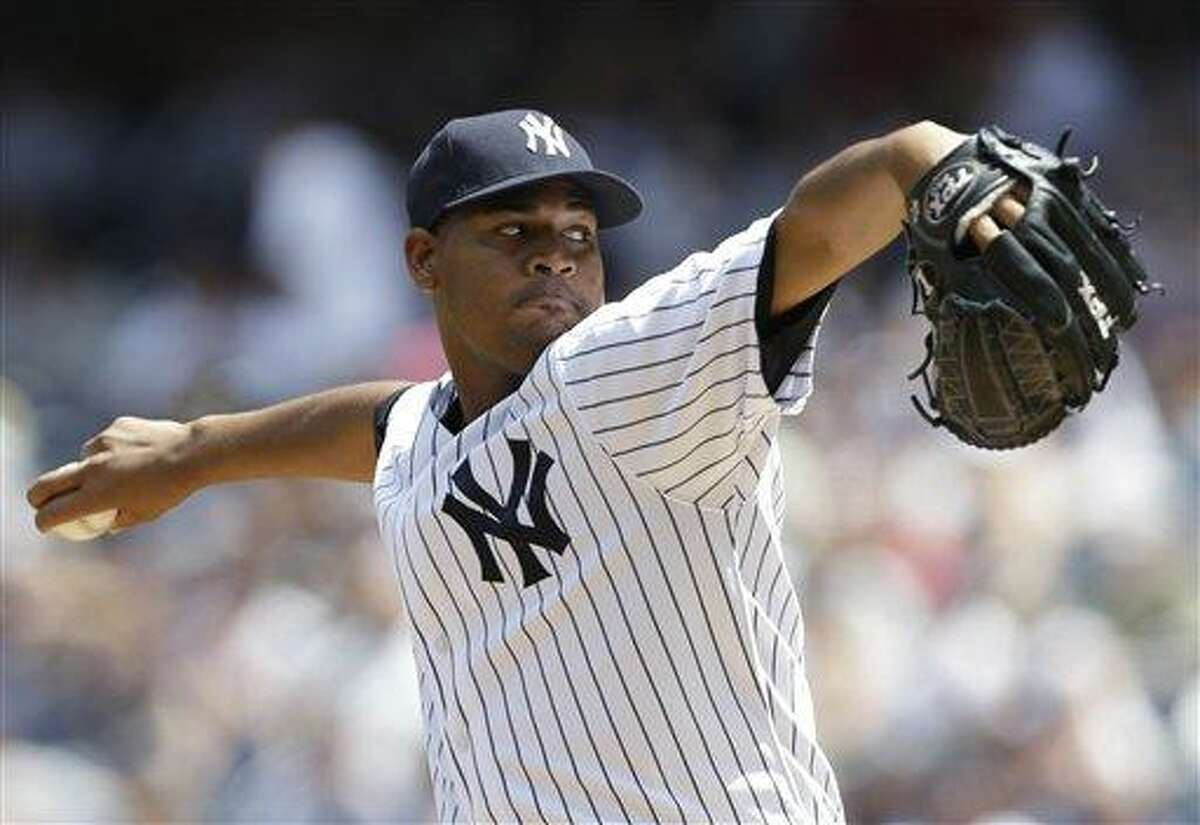 New York Yankees starting pitcher Ivan Nova delvers in the first inning against the Tampa Bay Rays in a baseball game Sunday, June 23, 2013, in New York. (AP Photo/Kathy Willens)