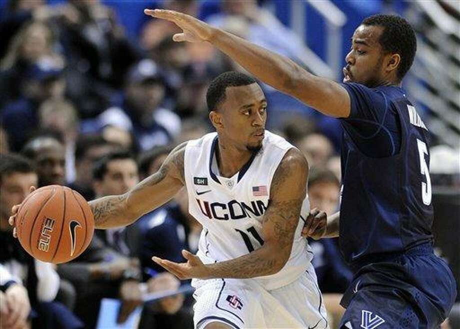 Connecticut's Ryan Boatright, left, is guarded by Villanova's Tony Chennault during the first half of an NCAA college basketball game in Hartford, Conn., Saturday, Feb. 16, 2013. (AP Photo/Fred Beckham) Photo: ASSOCIATED PRESS / AP2013