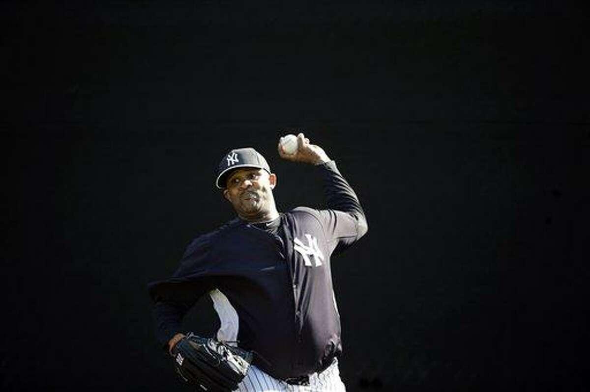 New York Yankees' CC Sabathia pitches during a workout at baseball spring training, Saturday, Feb. 16, 2013, in Tampa, Fla. (AP Photo/Matt Slocum)