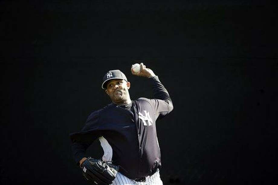 New York Yankees' CC Sabathia pitches during a workout at baseball spring training, Saturday, Feb. 16, 2013, in Tampa, Fla. (AP Photo/Matt Slocum) Photo: ASSOCIATED PRESS / AP2013