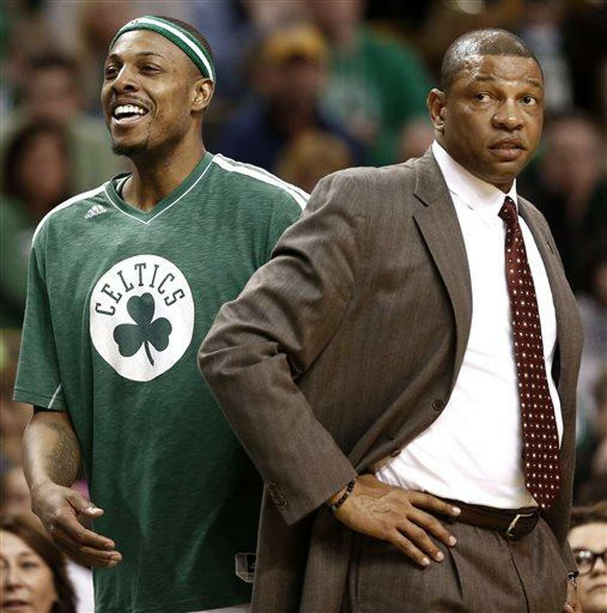 Boston Celtics' Paul Pierce, left, smiles next to head coach Doc Rivers during the fourth quarter of their 107-96 win over the Washington Wizards in an NBA basketball game in Boston, Sunday, April 7, 2013. (AP Photo/Winslow Townson)