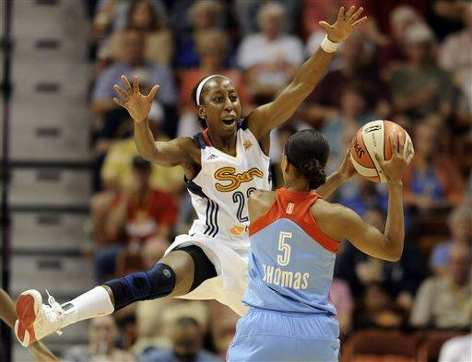 Connecticut Sun's Allison Hightower, left, defends against Atlanta Dream's Jasmine Thomas, right, during the first half of a WNBA basketball game in Uncasville, Conn., Sunday, June 23, 2013. (AP Photo/Jessica Hill) Photo: AP / FR125654 AP