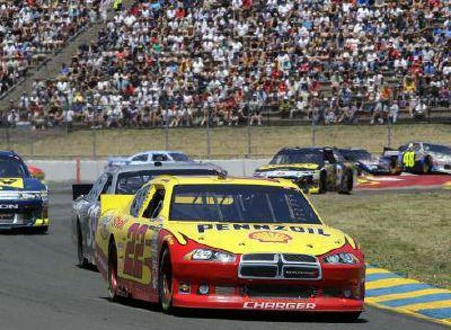 Kurt Busch, front, led the pack for most of the day at Infineon Raceway in Sonoma, Calif. in 2011.