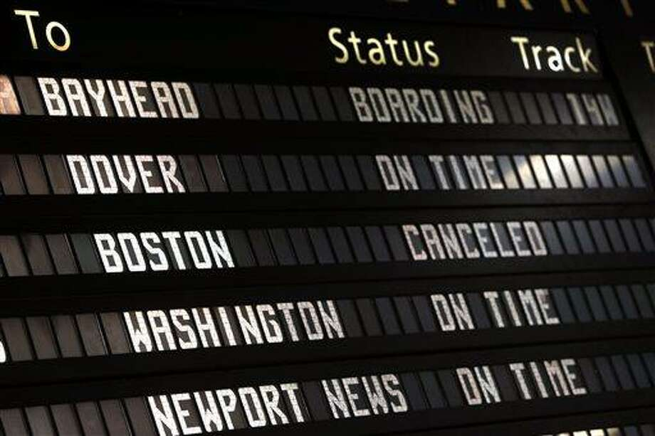 The Amtrak departures board shows a canceled train to Boston at Penn Station, Friday, April 19, 2013 in New York.  Mass transit to and from the Boston area was virtually shut down Friday as police conducted a massive manhunt for a suspect in Monday's Boston Marathon bombing. (AP Photo/Jason DeCrow) Photo: AP / FR103966 AP