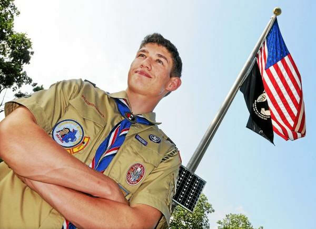 Catherine Avalone/The Middletown Press Middletown resident Tom Boller, 16, an Eagle Scout installed a solar panel to illuminate the American and Pow flags on the Washington Green for his Eagle Scout Service Project. Boller enlisted help from his fellow scouts at Troop 41 chartered by St. Mary Church and members of American Legion Post 75. A rising senior at Middletown High School, Boller earned 37 merit badges and was honored at an Eagle Court of Honor held at St. Sebastian Church Sunday.