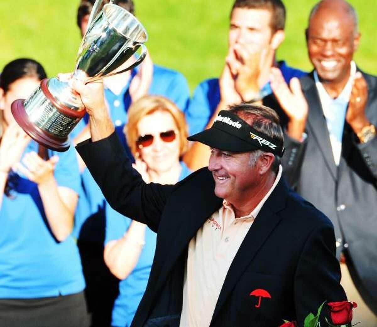 Peter Casolino â?? June 23, 2013- Ken Duke hoists the trophy after winning the 2013 Travelers Championship. pcasolino@newhavenregister.com