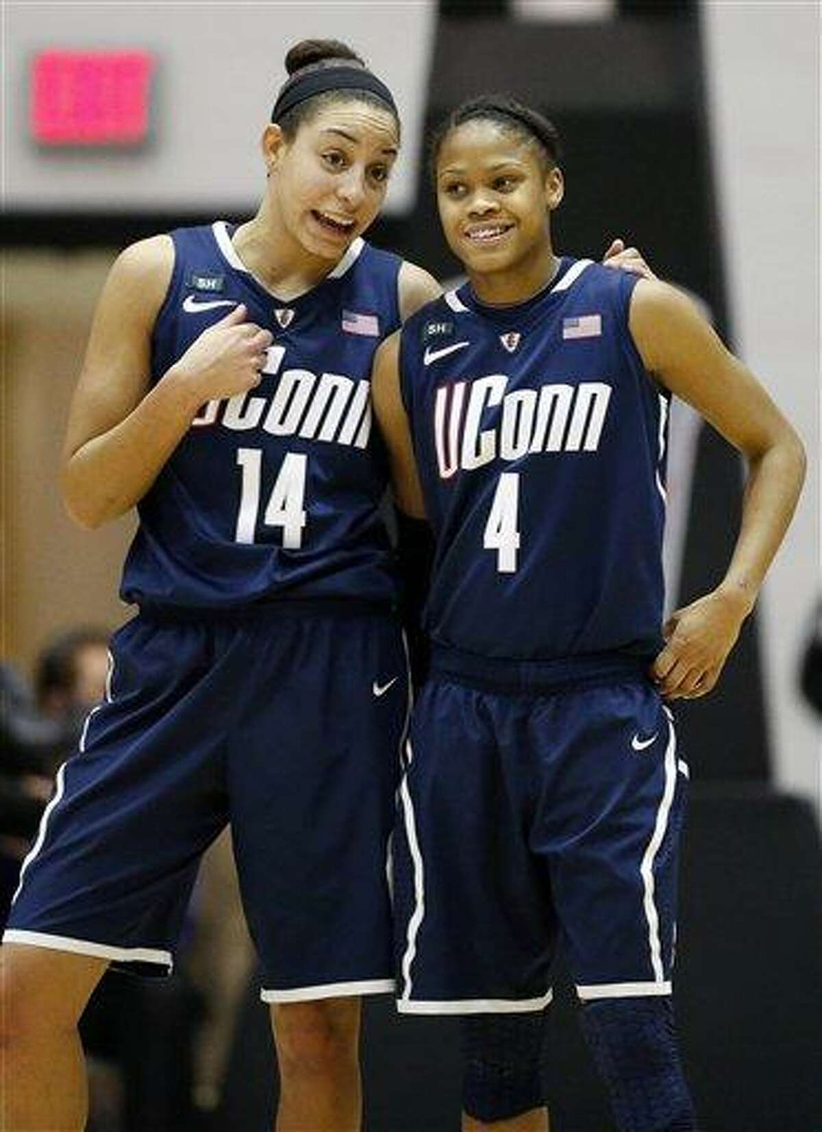 Connecticut's Bria Hartley (14) and Moriah Jefferson (4) talk during a timeout in the second half of an NCAA college basketball game against Providence in Providence, R.I., Tuesday, Feb. 12, 2013. Connecticut won 105-49. (AP Photo/Michael Dwyer)
