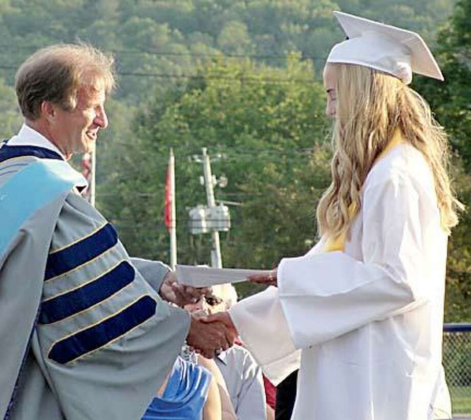 Michaela Soules receives the Ideal Senior Award from Dr. Jeff Bryant, the superintendent os schools. The award recipient is chosen annually by the senior class. Photo Special to the Dispatch by Jen Armstrong