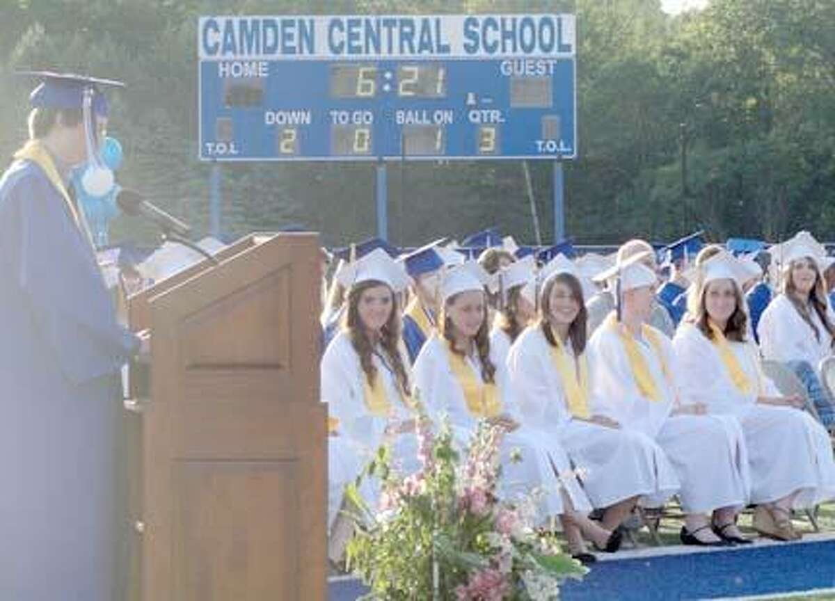 Camden Class of 2013 Valedictorian Alexander Allen addresses his classmates during commencement on Friday night at the high school stadium. Daphne Billington, Allen's grandmother, was also seated on the field and honored as a fifty-year graduate as a member of the CHS Class of 1963. Photo Special to the Dispatch by Jen Armstrong