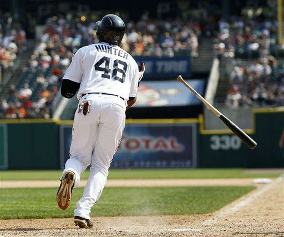 Detroit Tigers' Torii Hunter watches his sacrifice fly ball that scored Avisail Garcia to take a 5-4 lead over the Boston Red Sox in the eighth inning of a baseball game on Sunday, June 23, 2013, in Detroit. (AP Photo/Duane Burleson)