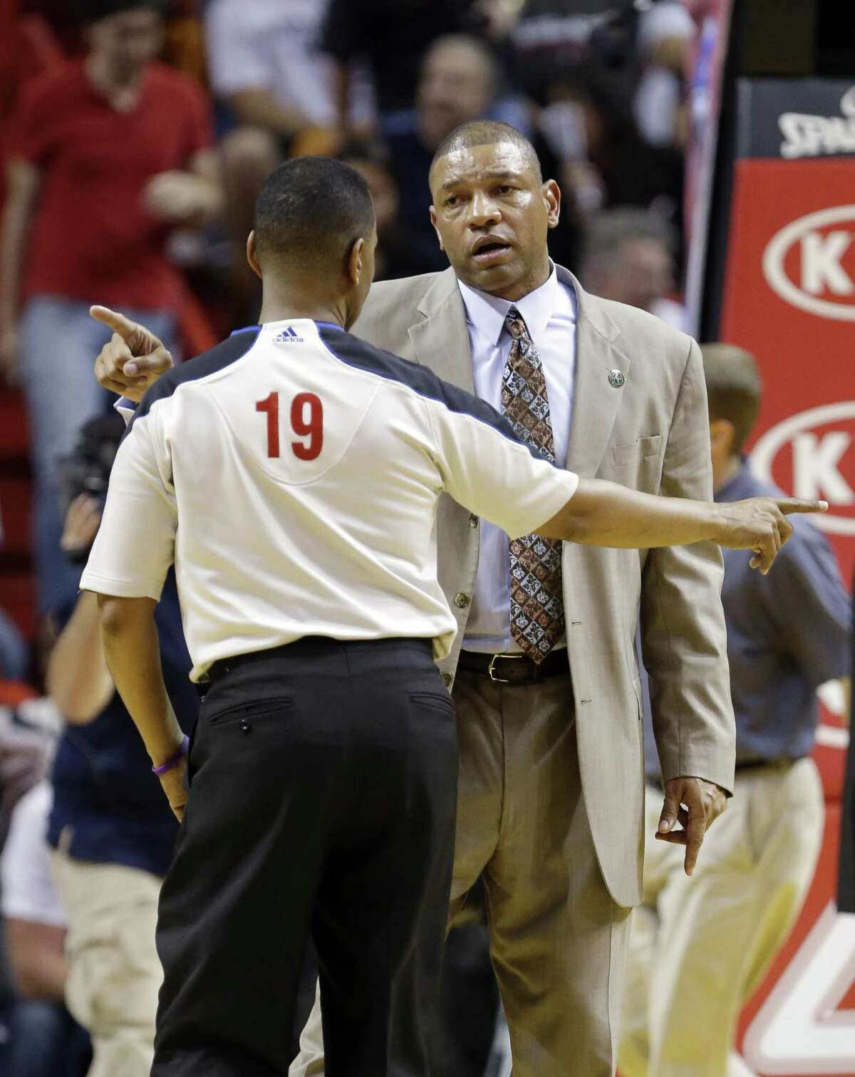 Boston Celtics head coach Doc Rivers, rear, argues a call with referee James Capers (19) during the second half of an NBA basketball game against the Miami Heat, Friday, April 12, 2013 in Miami. The Heat defeated the Celtics 109-101. (AP Photo/Wilfredo Lee)