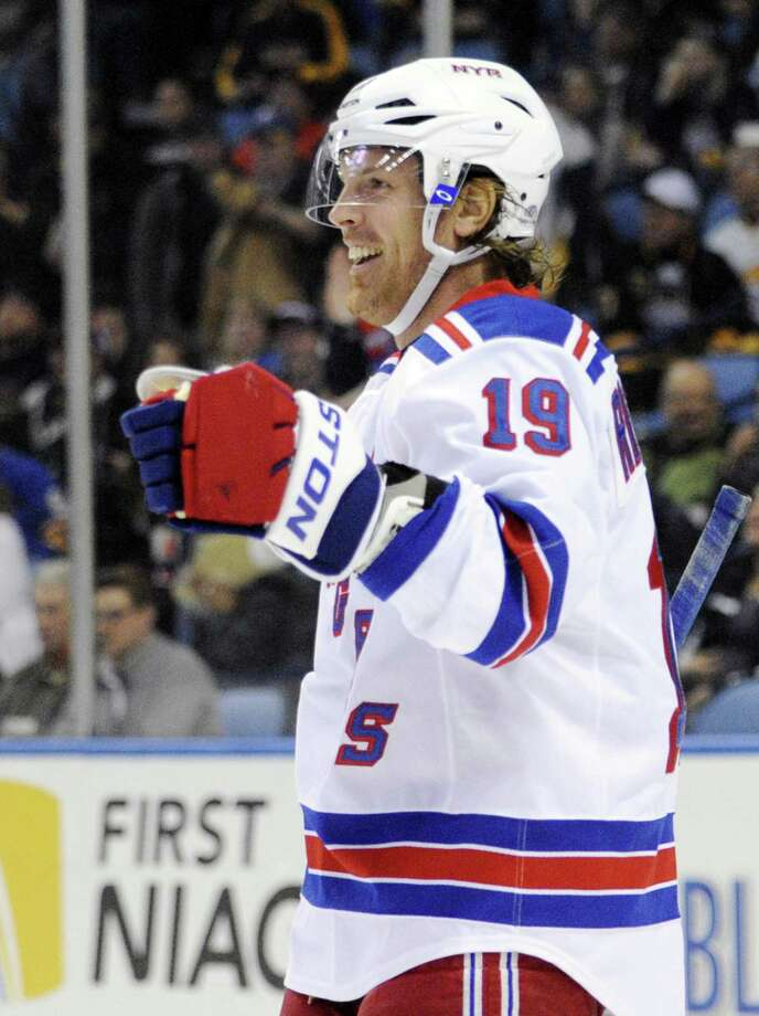 New York Rangers center Brad Richards celebrates his second of three goals against the Buffalo Sabres during the second period of an NHL hockey game in Buffalo, N.Y., Friday, April 19, 2013. New York won 8-4. (AP Photo/Gary Wiepert) Photo: AP / FR170498AP