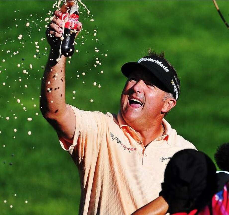 "Peter Casolino â?? June 23, 2013- Ken Duke pops open a coke after shaking it up, moments after winning the 2013 Travelers Championship. <a href=""mailto:pcasolino@newhavenregister.com"">pcasolino@newhavenregister.com</a>"