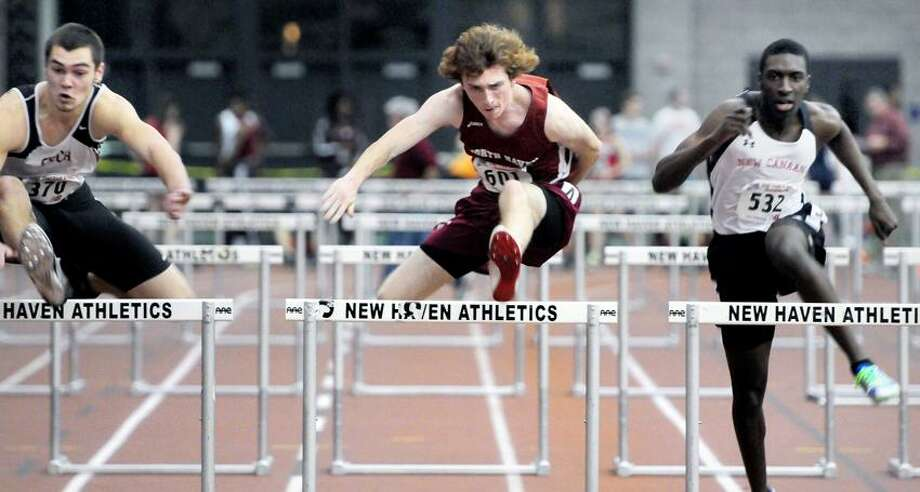 Left to right, Tyler Latham of Fitch, John Spencer of North Haven and Devaun Bovell of New Canaan compete in the 55m hurdles at the Class L Track Championships at the Floyd Little Athletic Center in New Haven on 2/15/2013.Photo by Arnold Gold/New Haven Register