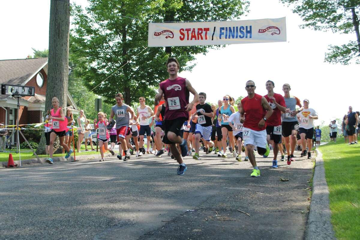 Runners start the Harwinton Road Race, a 3.4 mile course through the town. Jessica Glenza - Register Citizen