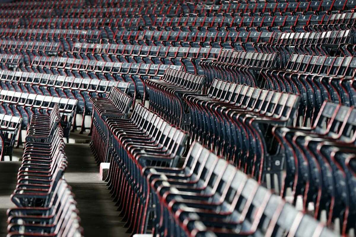 Seats at Fenway Park before a baseball game between the Boston Red Sox and the Tampa Bay Rays in Boston, Saturday, April 13, 2013. (AP Photo/Michael Dwyer)