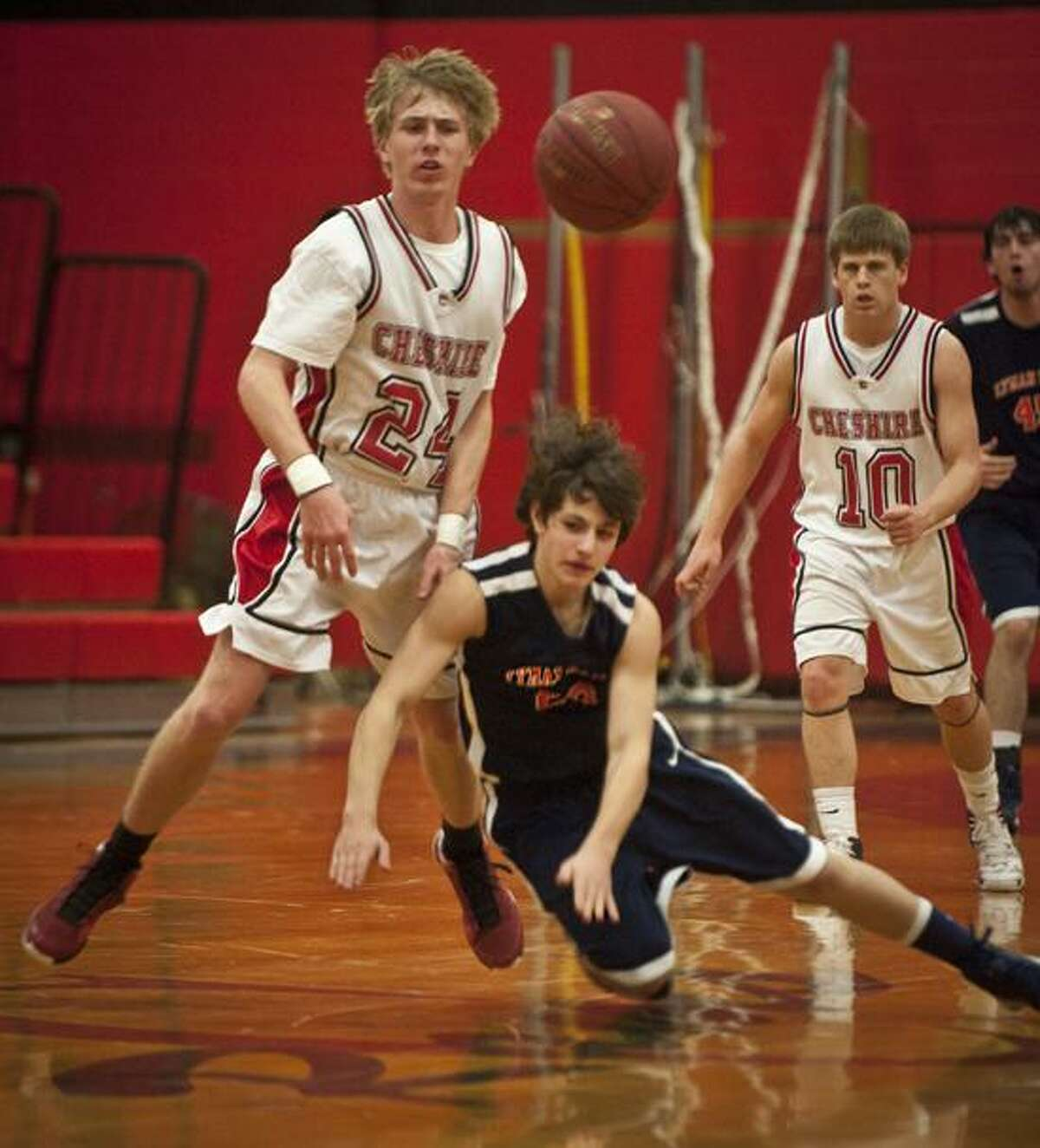 SPORTS-Lyman Hall's Eric Beardsley looses his footing, and the ball in 1st half action at Cheshire. At left is Ram's Kevin Dietrich. Melanie Stengel/Register