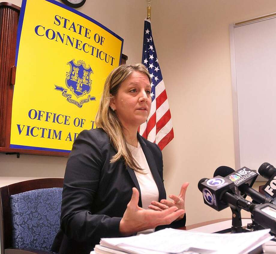 West Haven-- State Victim Advocate Michelle Cruz speaks to the media about the investigation into the domestic violence murder of Shengyul Rasim in 2010.  Photo-Peter Casolino 2/15/13