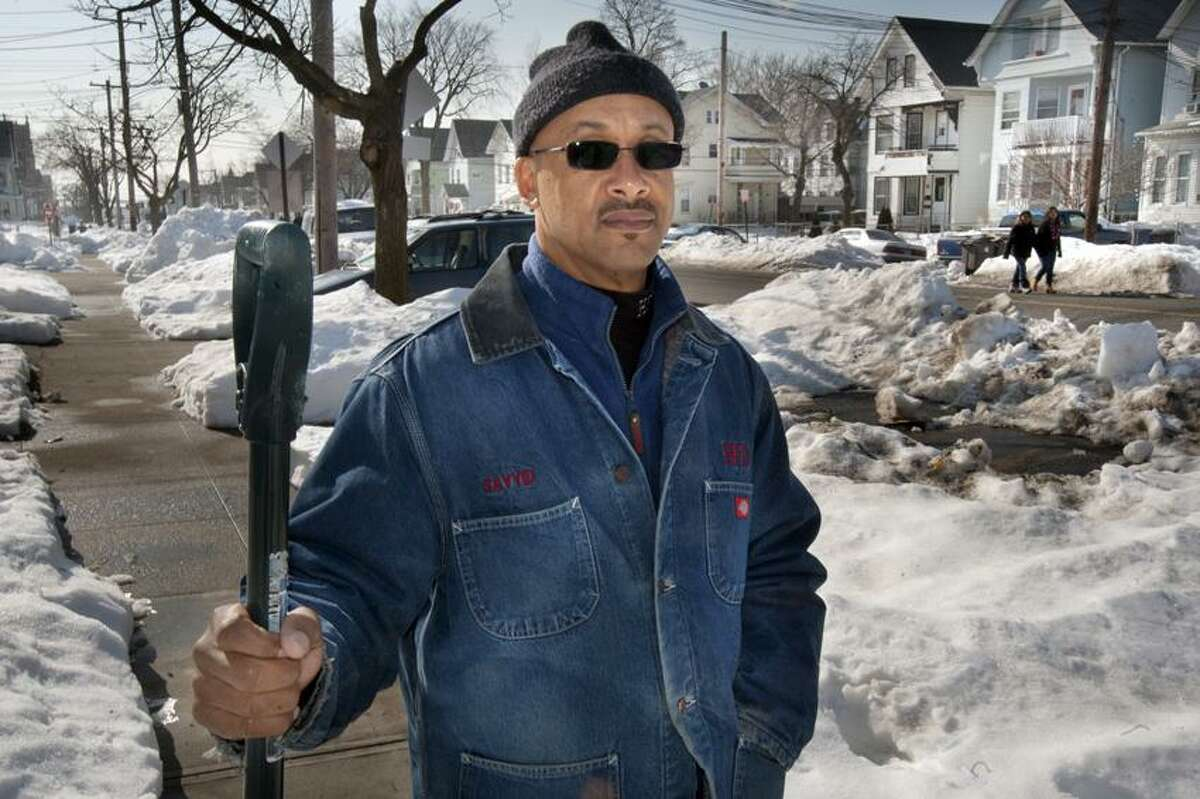 Mr. Sayyid Abdur Rahman, pictured, was helped by two young men last Friday removing his car from being stuck in the snow- then they turned on him and rob him at gun point February 15, 2013. vmWilliams