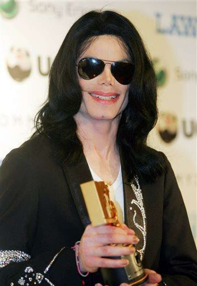 FILE - In this May 27, 2006 file photo, Michael Jackson smiles during a press conference of the MTV Video Music Awards Japan 2006 in Tokyo. The U.S. entertainer was awarded a Legend Award at the ceremony. Jurors hearing a civil case in Los Angeles filed by Jackson's mother, Katherine Jackson, have heard numerous stories about the entertainer's devotion to his children as expressed through extravagant birthday parties and secret family outings. The tender moments have been described throughout the trial, which concluded its eighth week on Friday, June 21, 2013. (AP Photo/Koji Sasahara, File) Photo: AP / AP