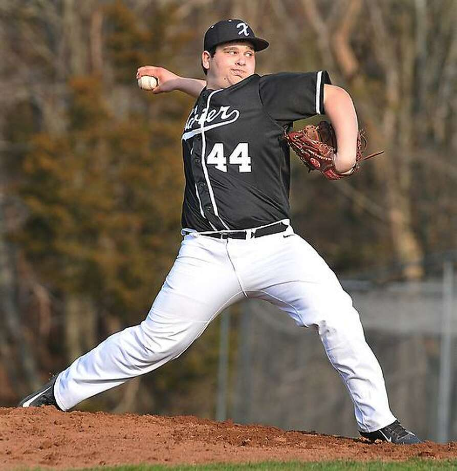 Catherine Avalone/The Middletown Press In this file photo, Xavier sophomore John Signore pitches in the seventh inning against Fairfield Prep earlier this season. / TheMiddletownPress