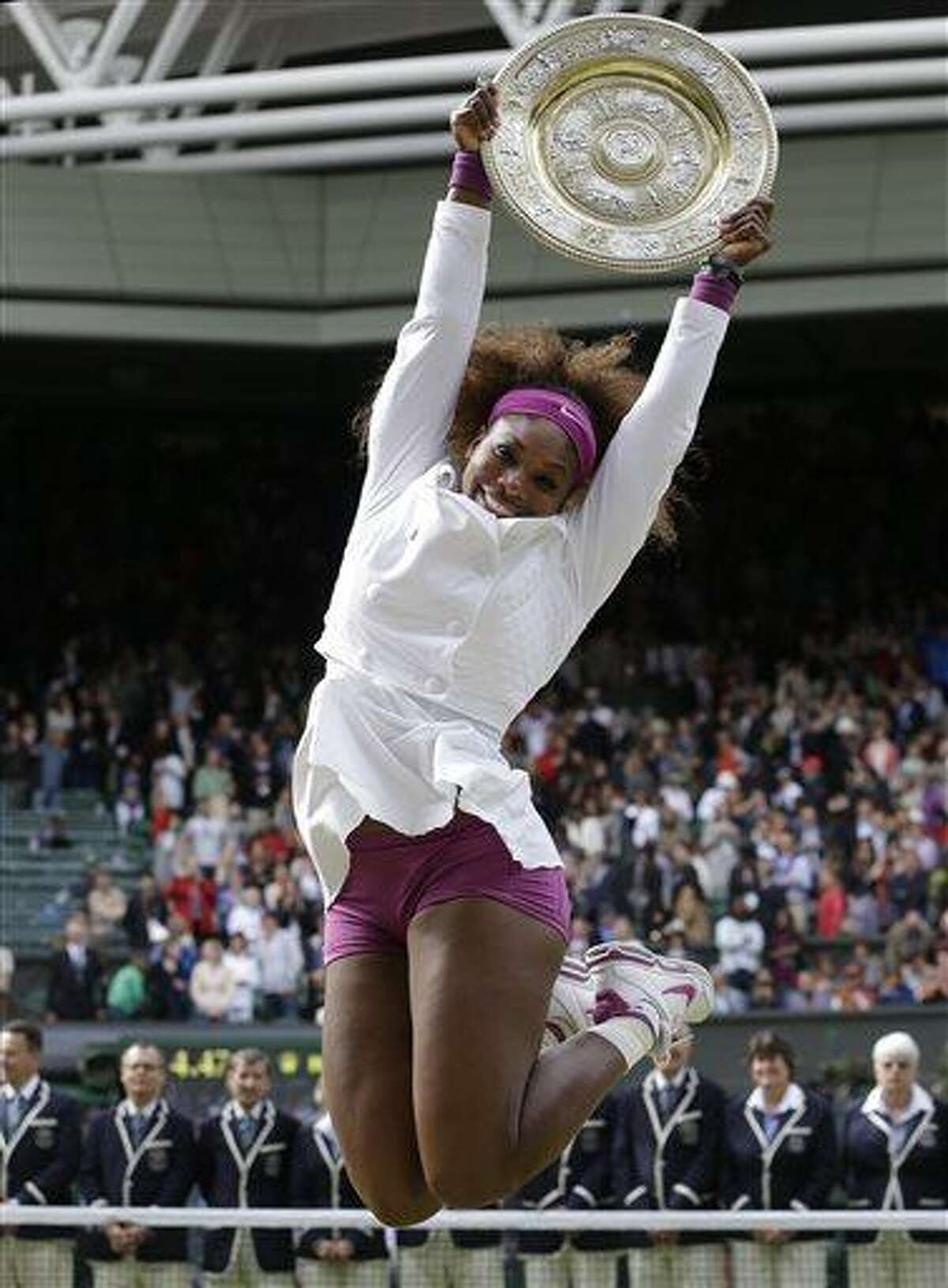 FILE - In this July 7, 2012 file photo, Serena Williams celebrates with the trophy after defeating Agnieszka Radwansk to win the women's final match at the All England Lawn Tennis Championships at Wimbledon, England. When Wimbledon starts Monday, June 24, 2013, she will be on a 31-match winning streak and an overwhelming favorite to win her second consecutive title. (AP Photo/Kirsty Wigglesworth, File)