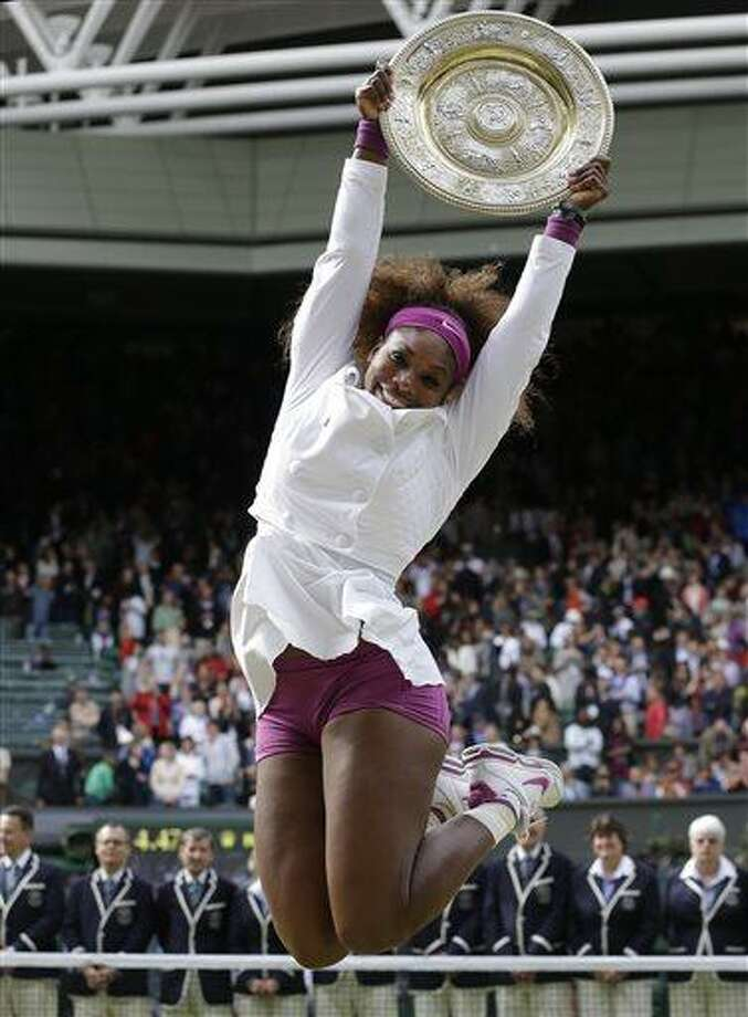 FILE - In this July 7, 2012 file photo, Serena Williams celebrates with the trophy after defeating Agnieszka Radwansk to win the women's final match at the All England Lawn Tennis Championships at Wimbledon, England. When Wimbledon starts Monday, June 24, 2013, she will be on a 31-match winning streak and an overwhelming favorite to win her second consecutive title.  (AP Photo/Kirsty Wigglesworth, File) Photo: AP / AP