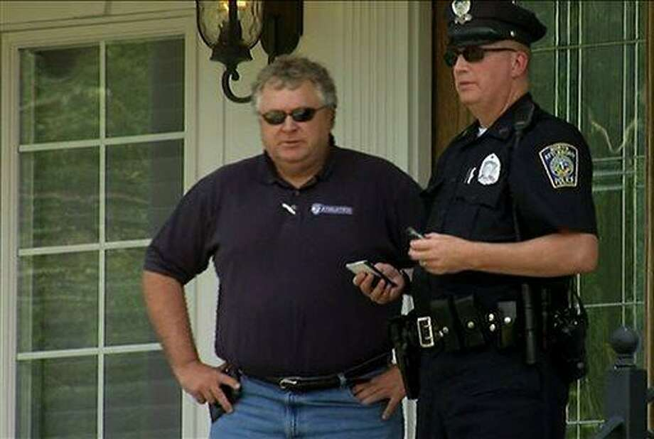 In this image taken from video, police officers talk outside of  the home of New England Patriots football player Aaron Hernandez, Saturday, June 22, 2013, in North Attleboro, Mass. State police officers and dogs searched Hernandez's home as they investigate the killing of Odin Lloyd, a semi-pro football player whose body was found nearby. (AP Photo/ESPN) Photo: AP / ESPN