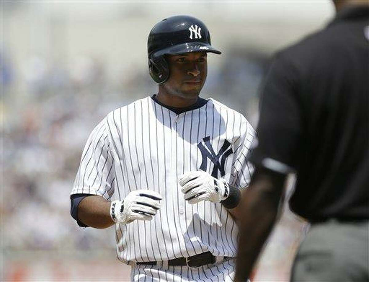 New York Yankees' Zoilo Almonte reacts after hitting a single to drive in two runs during the third inning of a baseball game Tampa Bay Rays Saturday, June 22, 2013, in New York. (AP Photo/Frank Franklin II)