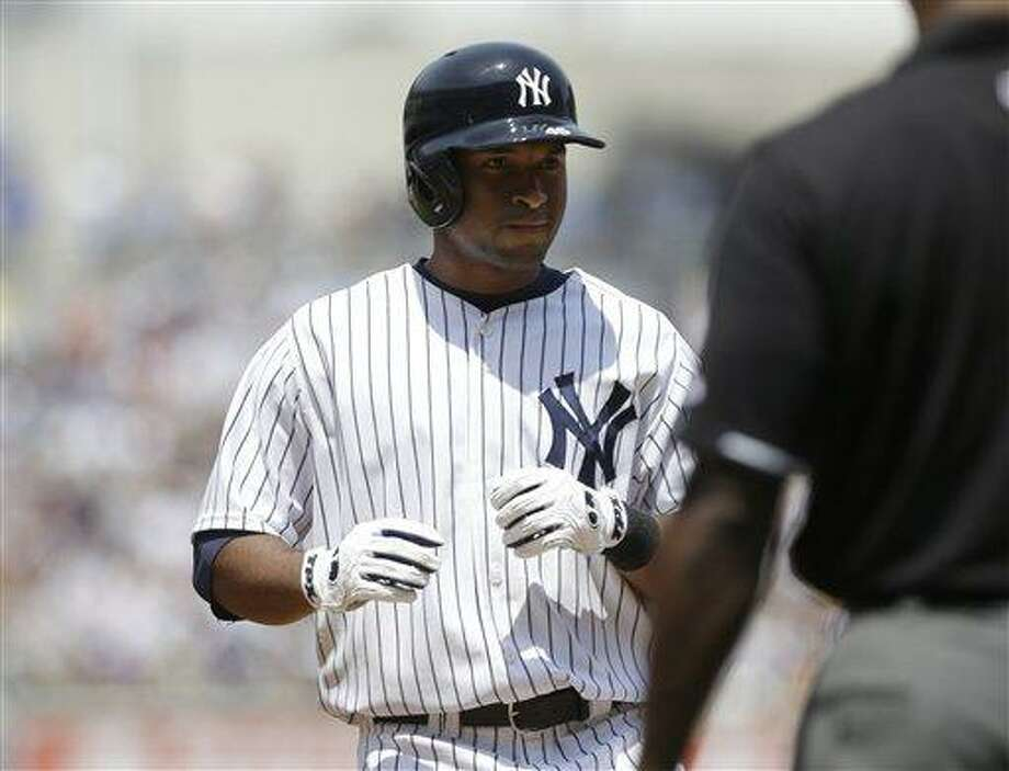 New York Yankees' Zoilo Almonte reacts after hitting a single to drive in two runs during the third inning of a baseball game Tampa Bay Rays Saturday, June 22, 2013, in New York. (AP Photo/Frank Franklin II) Photo: AP / AP