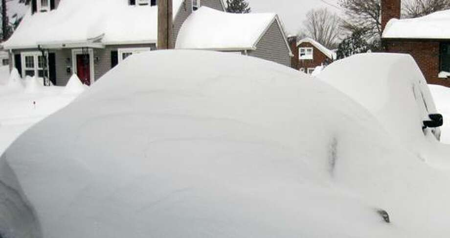 Submitted by Robert Avalone   The view on Saturday of the snow covered autos in my driveway.