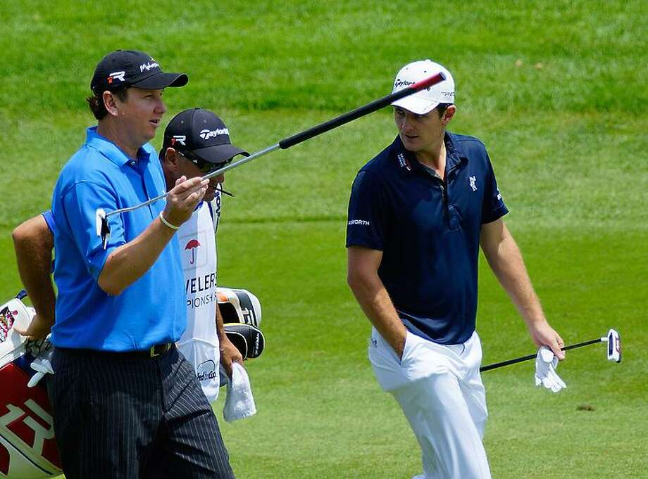 """Peter Casolino -- June 22, 2013-  J.J  Henry and Justin Rose chat on the first hole. <a href=""""mailto:pcasolino@newhavenregister.com"""">pcasolino@newhavenregister.com</a>"""
