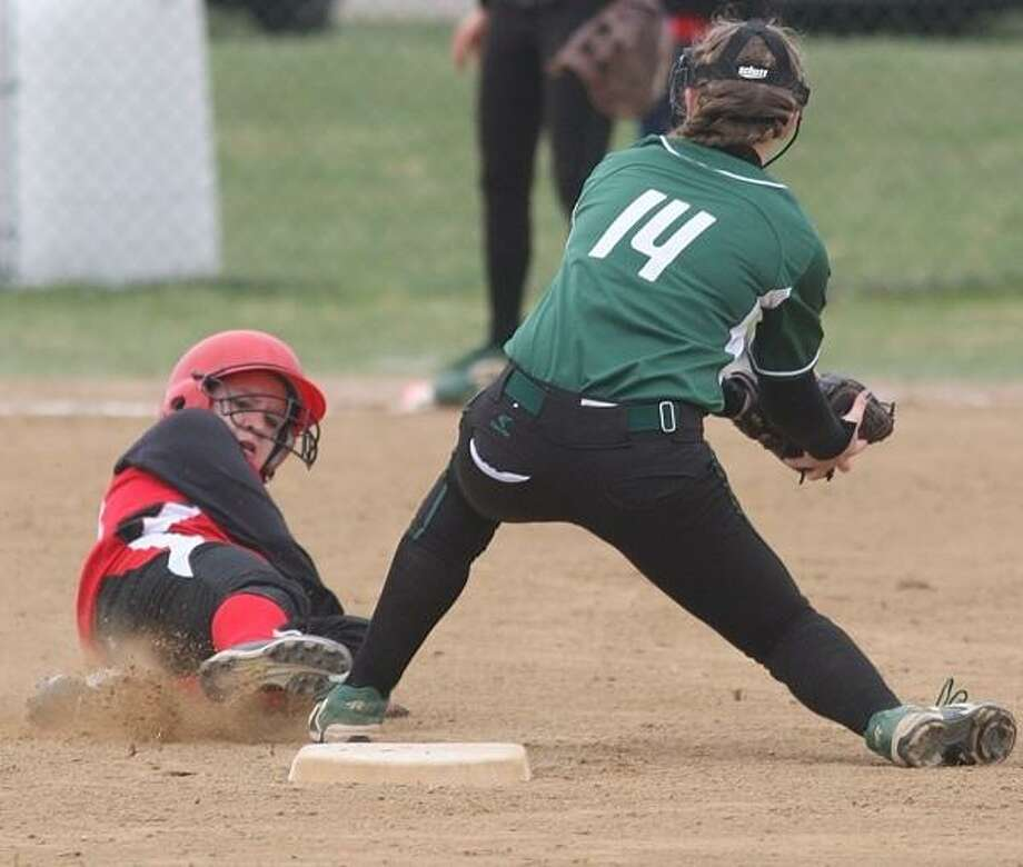 PHOTO BY JOHN HAEGER @ ONEIDAPHOTO ON TWITTER/ONEIDA DAILY DISPATCH Hamilton's Hayden Nolan tags Morrisville-Eaton's Shelby Brown (14) out as she tries to steal second during their game on Friday, April 19, 2013 in Morrisville.