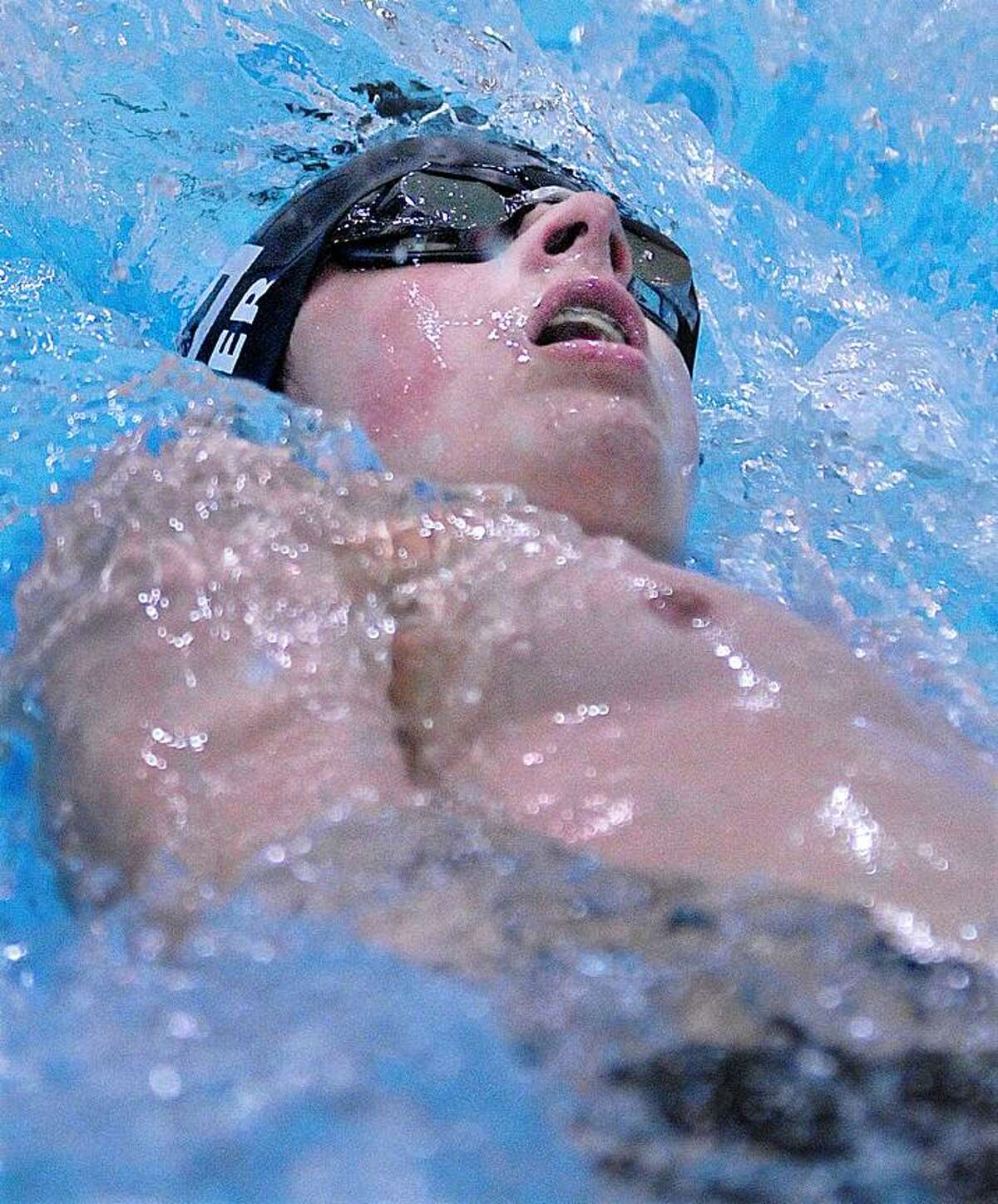 Catherine Avalone/The Middletown PressXavier sophomore Michael Primer placed first in the 100 yard backstroke with an official itme of 1:02.56 against Cheshire Friday night at the Wesleyan University Natatorium at Freeman Athletic Center in Middletown. Xavier defeated Cheshire 99-85.