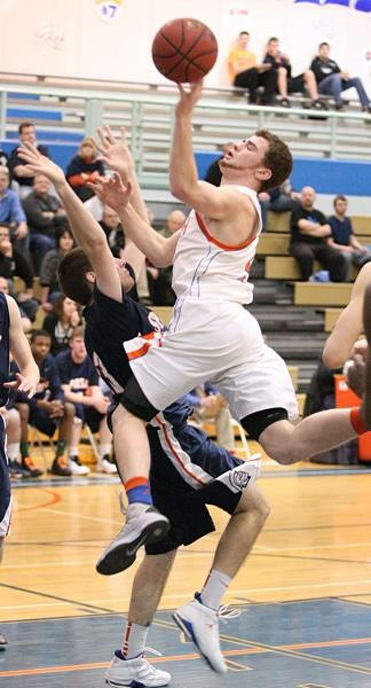 Dispatch Staff Photo by JOHN HAEGER (Twitter: @OneidaPhoto) Oneida's Kyle Peck (5) is fouled by ES-M's Bryan Reader (23) during the first half of their Class A playoff game in Oneida on Friday, Feb. 15, 2013. Peck scored 29 in Oneida's 67-64 overtime victory.