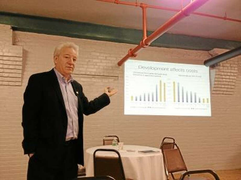 Bill Fulton, one of the vice presidents for Smart Growth America, told the town officials in attendance that Winsted would need to build up downtown and attract more young residents to help build the town's tax base. JASON SIEDZIK/ Register Citizen