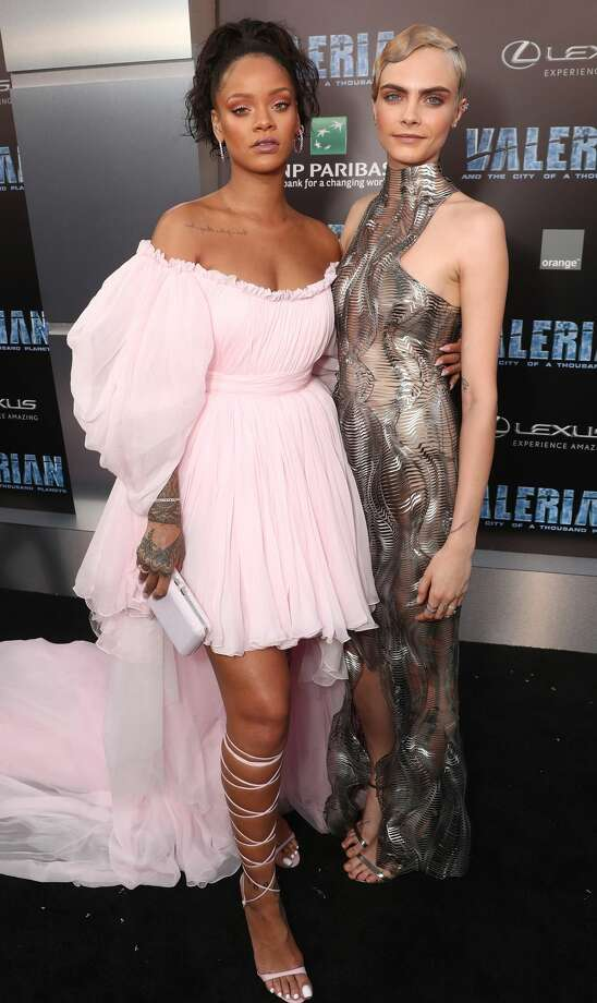 """Rihanna and Cara Delevingne attend the premiere of EuropaCorp And STX Entertainment's """"Valerian And The City Of A Thousand Planets"""" at TCL Chinese Theatrein Hollywood, California, on July 17, 2017. Photo: Todd Williamson/Getty Images"""