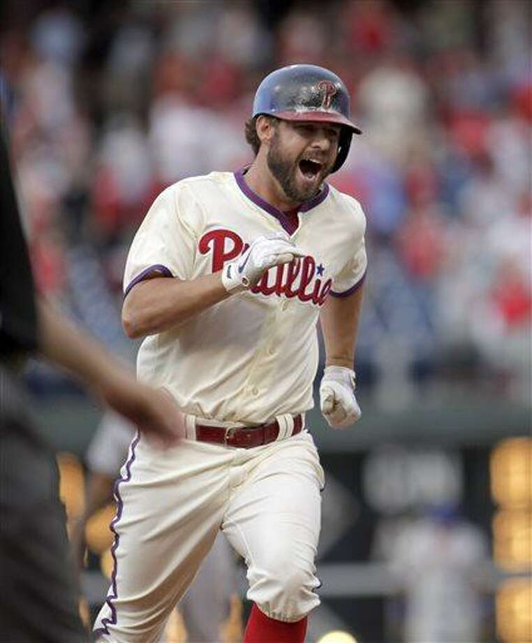 Philadelphia Phillies' Kevin Frandsen runs the bases after he hit a solo home run against the New York Mets in the ninth inning of a baseball game Saturday, June 22, 2013, in Philadelphia. The Phillies won 8-7.  (AP Photo/H. Rumph Jr) Photo: AP / FR61717 AP