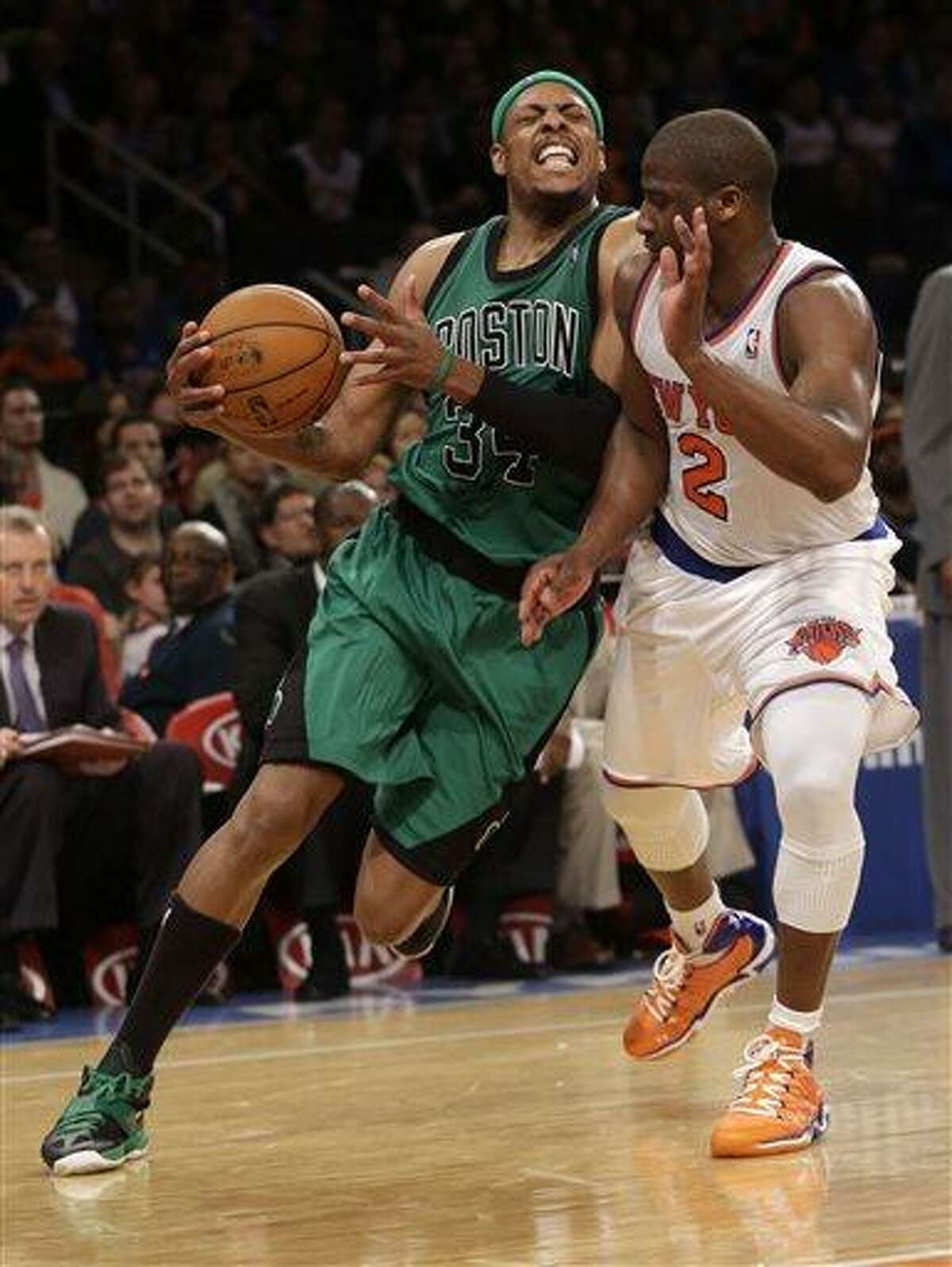 Boston Celtics' Paul Pierce, left, is fouled by New York Knicks' Raymond Felton during the second half of the NBA basketball game at Madison Square Garden Sunday, March 31, 2013 in New York. The Knicks beat the Celtics 108-89. (AP Photo/Seth Wenig)
