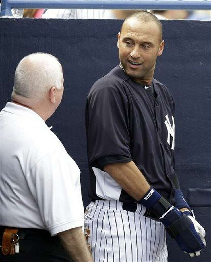 FILE - In this March 9, 2013, file photo, New York Yankees shortstop Derek Jeter talks with trainer Steve Donohue after batting as the designated hitter in a spring training baseball game against the Altanta Braves in Tampa, Fla. The Yankees said Thursday, April 18, 2013, that Jeter will be sidelined until after the All-Star break because of a new fracture in his injured left ankle. (AP Photo/Kathy Willens, File) Photo: ASSOCIATED PRESS / AP2013