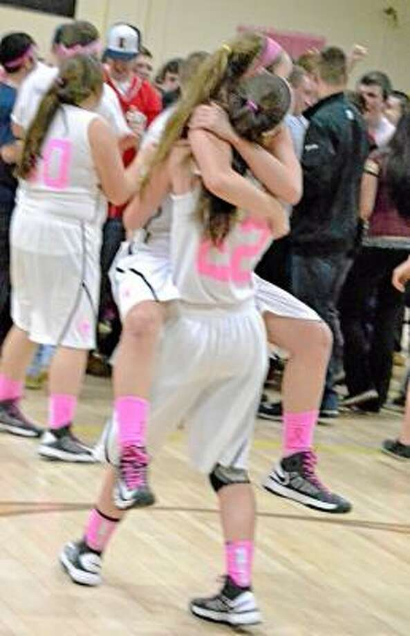 Maggie Eberhardt lifting up her fellow senior Sydney Keith after they won the Berkshire League Championship. Pete Paguaga/Register Citizen.