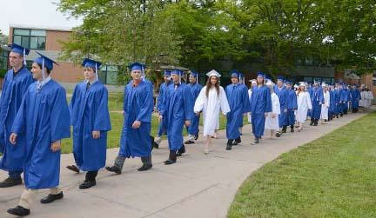 Members of the Oneida High School Class of 2013 march into the commencement area Saturday. (Dispatch Staff Photo by KURT WANFRIED)