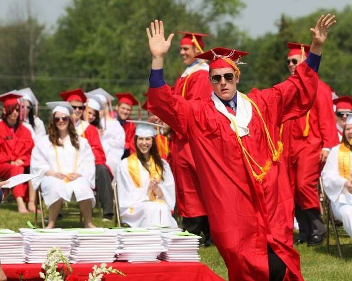 JOHN HAEGER @ONEIDAPHOTO ON TWITTER/ONEIDA DAILY DISPATCH Jared Fiacco reacts as he make his way to receive his diploma during the VVS Central School 63rd Commencement exercises on Saturday, June 22, 2013 in Verona.