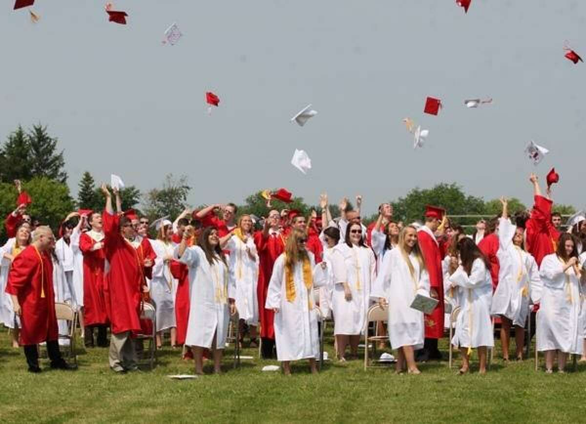 JOHN HAEGER @ONEIDAPHOTO ON TWITTER/ONEIDA DAILY DISPATCH VVS Class of 2013 members throw their caps into the air following the VVS Central School 63rd Commencement exercises on Saturday, June 22, 2013 in Verona