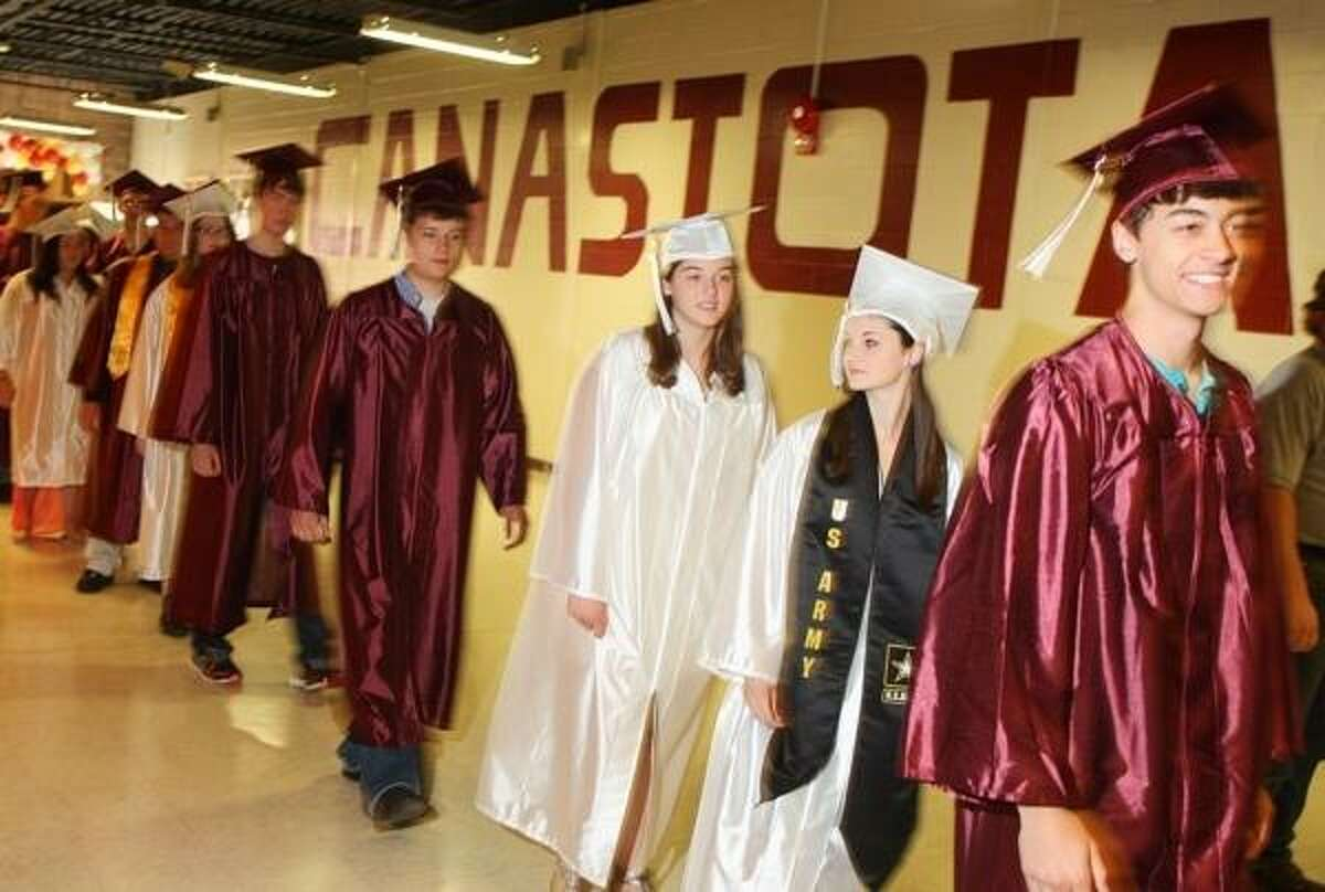 JOHN HAEGER @ONEIDAPHOTO ON TWITTER/ONEIDA DAILY DISPATCH Canastota class of 2013 members make their way into the gym for the start of the Canastota High School 132nd Commencement exercises on Saturday, June 22, 2013 in Canastota.