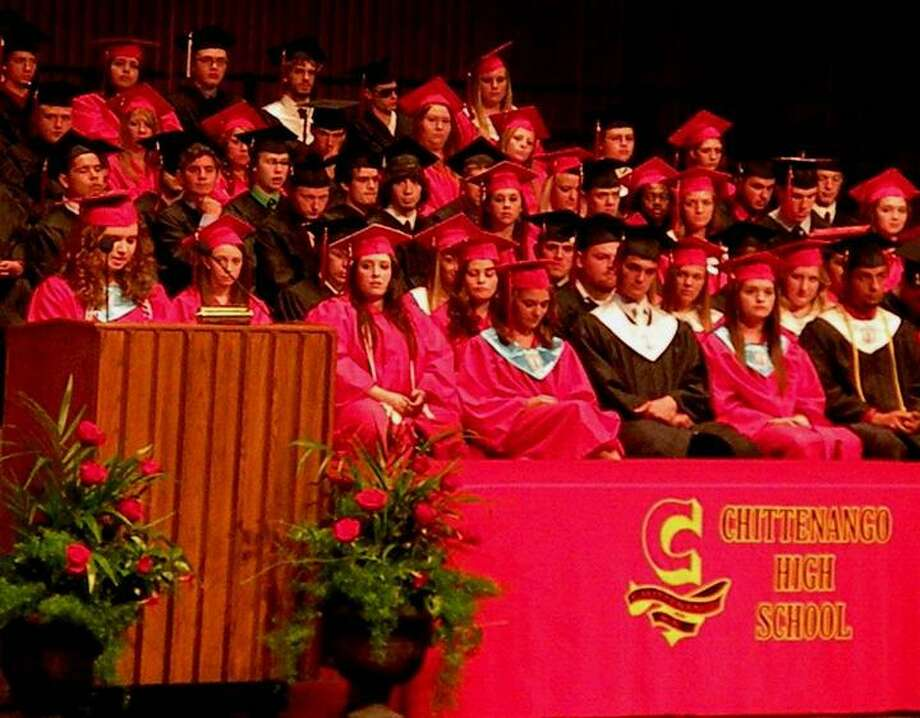 Photo Courtesy Michael Yeoman Valedictorian Emily Norman reflects on the past and the future as class members listen during the 138th Commencement exercises for Chittenango High School on Friday, June 21, 2013.