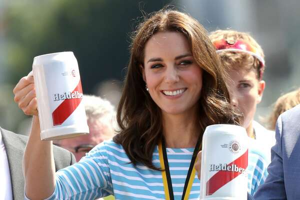 HEIDELBERG, GERMANY - JULY 20:  Catherine, Duchess of Cambridge celebrates with a beer after participating in a rowing race between the twinned town of Cambridge and Heidelberg and against Prince William, Duke of Cambridge on day 2 of their official visit to Germany on July 20, 2017 in Heidelberg, Germany.  (Photo by Chris Jackson/Getty Images)