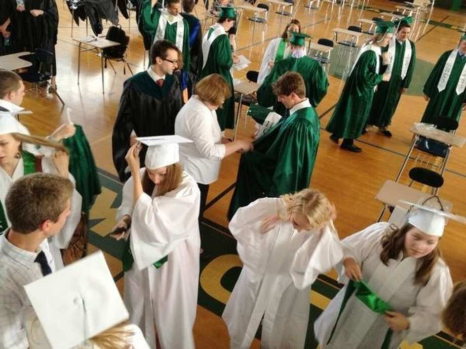 JOHN HAEGER @ONEIDAPHOTO ON TWITTER/ONEIDA DAILY DISPATCH Members of the Hamilton Class of 2013 get ready before the start of the  Hamilton Central School 115th Commencement exercises on Saturday, June 22, 2013 in Hamilton.