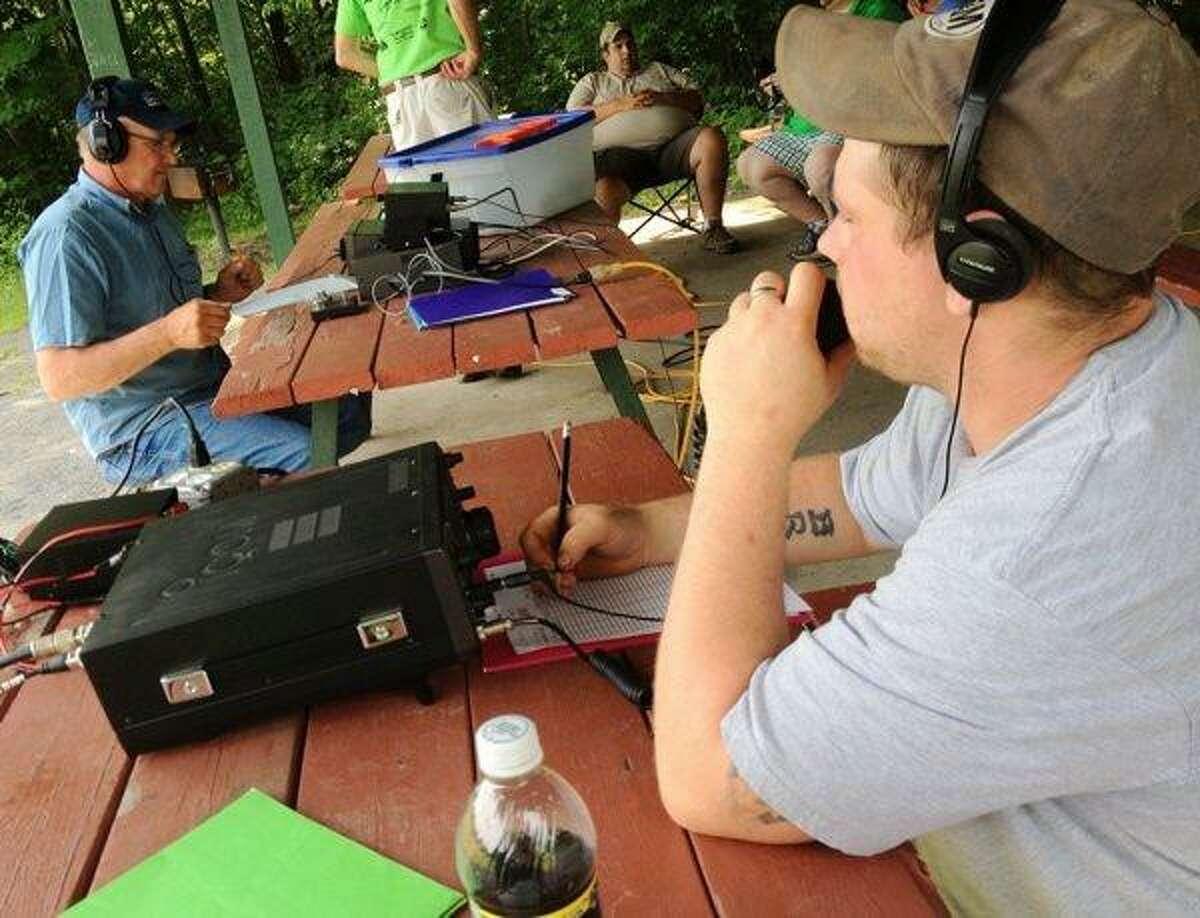 JOHN HAEGER @ONEIDAPHOTO ON TWITTER/ONEIDA DAILY DISPATCH Brain Pratt KD2ADK left, and John Payne KC2AOA members of the Madison Oneida Amateur Club (MOARC) take part in the America Radio Relay League (ARRL) nation wide field days on Saturday, June 22, 2013 at Oxbow Park.
